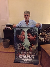 The Author - Stephen Leather with The Foreigner poster